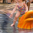 Young girl playing in water — Stock Photo