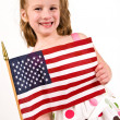 Young Caucasian girl holding an American Flag — Stock Photo