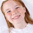 Young girl in her First Communion dress — Stock Photo