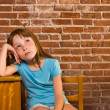 Young girl leaning on school desk while thinking — Stock Photo