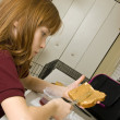 Young school girl preparing a healthy lunch for school — Stock fotografie #23257284