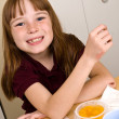 Постер, плакат: Young school girl eating a healthy lunch