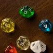Stock Photo: Multicolored Role Play Dice on wooden table top