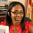 Stock Photo: Beautiful African American receptionist or customer service representative