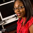 Beautiful African American receptionist or customer service representative — Stock Photo