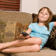 Young female child watching television — Stockfoto