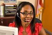Beautiful African American receptionist or customer service representative — ストック写真