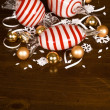 Large Blown Glass Peppermint Candy, Small Christmas Bulbs and snowflakes — Stock Photo