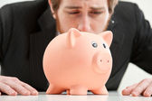 Cruel world, piggybank have to be sacrificed — Stock Photo