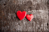 Love of red hearts on wooden background — Stock Photo