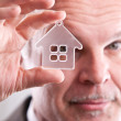 Man looking through a little house in front of you — Stock Photo #43053465