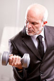 Weightlifting business man in action — Stock Photo