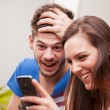 Man and woman having fun with their mobile phones — Stockfoto #45435527