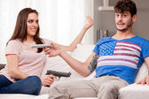 Weapons: woman demanding for remote control  — Stock Photo