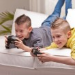 Two kids playing video games — Stock Photo #48014813