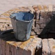 A water well with an old bucket in Samarkand, Uzbekistan — Stock Photo #23527303
