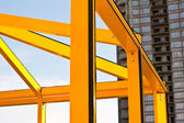 Steel orange frame of business building under construction. — Stock Photo