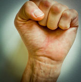Fist raised up. Concept for change, revolution, rebellion, motivation, action — Stock Photo