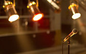 Close up of microphone in concert hall or conference room — Stock Photo