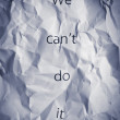 Stock Photo: Crumpled paper with words We can't do it. Concept for business workteam motivation, productive teamwork, cooperation.