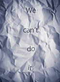 Crumpled paper with words We can't do it. Concept for business workteam motivation, productive teamwork, cooperation. — Stock Photo