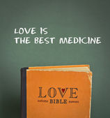 Love is the bet medicine. Love Bible with love commandments, metaphors and quotes — Stock Photo