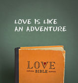 Love is like an adventure. Love Bible with love commandments, metaphors and quotes — Stock Photo