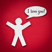 Papier person mit sprechblase und worten ich liebe dich! auf rotem hintergrund — Stockfoto