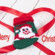 Christmas ornamente with red ribbon on background — Stok fotoğraf