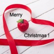 Christmas ornamente with red ribbon on background — Foto de stock #32395099