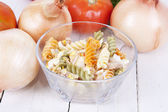 Bowl of macaroni with background — Stock Photo