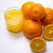 Orange juice and oranges — Stock Photo #40307791