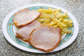 Marinated pork tenderloin with fries — Stock Photo