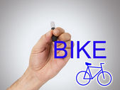 Hand with bike — Stock Photo