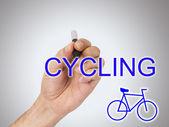 Hand with bike — Stockfoto