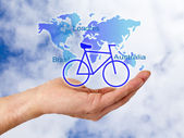 With holidays and cycling in his hands — Stock Photo