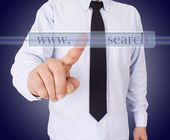 Businessman pointing to a button — Stock Photo