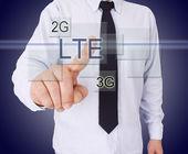 Businessman pressing button — Stock Photo