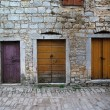 Three closed doors in the old town — ストック写真