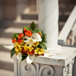 Bouquet on a handrail — Stock Photo