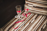 Glasses decorated with red tapes. — Stock Photo