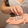 Earrings from pearls in hands. — Stock Photo #50312755