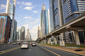 View of skyscrapers and Dubai Metro along Sheikh Zayed Road — Stock Photo