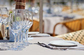 Beautiful table setting in an outdoor restaurant — Stock Photo