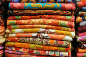 Pile of traditional colorful Arabic scarves — Stock Photo