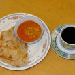 Roti Canai with Lentil Curry and Cup of coffee — Stock Photo