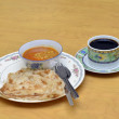 Roti Canai with Lentil Curry and Coffee for breakfast — Stock Photo