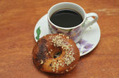Sweet chocolate donut with a cup of coffee — Stock Photo