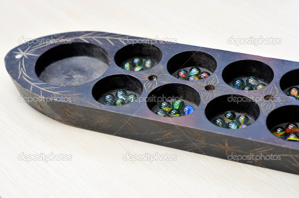 Congkak board, Malay tradiotional game � Stock Photo � namzahs ...