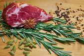 Sliced meat with cardamon — Stock Photo